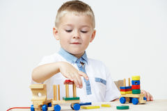 Pre-School Pupil Playing With Wooden Toy Train Royalty Free Stock Photos