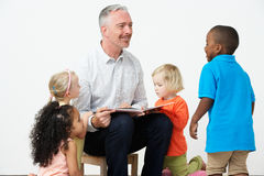 Pre School Teacher Reading Story To Children Royalty Free Stock Photo