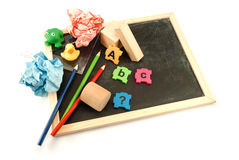 Pre school tools. Colorful pre-school items over white background Stock Image