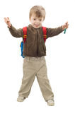 Pre-scool child. Pre-school child wearing schoolbag, holding crayons Stock Photos