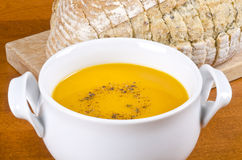 Pre-sliced Bread and Carrot Soup Stock Image