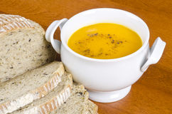 Pre-sliced Bread and Carrot Soup Royalty Free Stock Photography