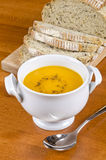 Pre-sliced Bread and Carrot Soup Royalty Free Stock Photos