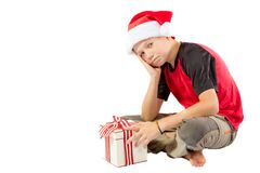 Pre-teen boy with a christmas gift Royalty Free Stock Images