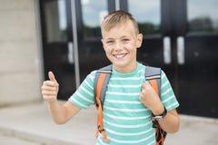 Pre teen boy outside at school. A nice Pre teen boy outside at school stock images