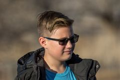 Pre-teen boy outside wearing sunglasses royalty free stock photo