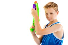 Pre-teen boy playing with water guns stock photos