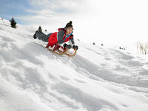 Pre-teen Boy On A Sled In The Snow. Laughing excited stock photos