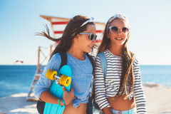Pre teen children with skateboards Royalty Free Stock Photo