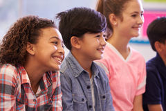 Pre-teen elementary school kids in a lesson Stock Image