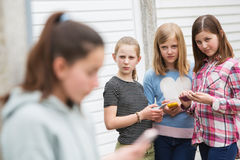 Pre Teen Girl Being Bullied By Text Message. Unhappy Pre Teen Girl Being Bullied By Text Message Stock Images