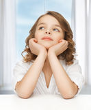 Pre-teen girl in casual clothes. Picture of thinking pre-teen girl in casual clothes Royalty Free Stock Photography