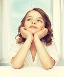 Pre-teen girl in casual clothes. Picture of thinking pre-teen girl in casual clothes Stock Images