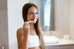 Pre teen girl in the hotel bathroom Stock Photos