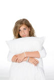 Pre teen girl hugging pillow Stock Photo