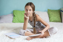 Pre teen girl relaxing at home Stock Images