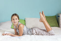Pre teen girl relaxing at home Royalty Free Stock Photo