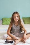Pre teen girl relaxing at home Stock Photos