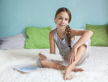 Pre teen girl relaxing at home Stock Image