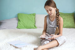 Pre teen girl relaxing at home Stock Photos