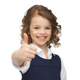 Pre-teen girl showing thumbs up. Happy children and gestures concept - picture of beautiful pre-teen girl showing thumbs up Stock Photography