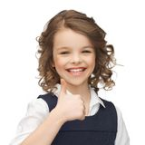 Pre-teen girl showing thumbs up. Happy children and gestures concept - picture of beautiful pre-teen girl showing thumbs up Stock Photos