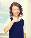 Pre-teen girl showing thumbs up. Picture of beautiful pre-teen girl showing thumbs up Stock Photography