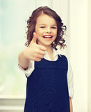 Pre-teen girl showing thumbs up Royalty Free Stock Images