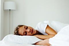 Pre teen girl sleepeng. Pre teen kid girl sleeping in the bed. Tired school girl dreaming in the morning Stock Photos