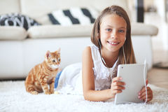 Pre teen girl with tablet pc Royalty Free Stock Photos