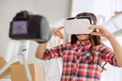 Pre-teen girl telling how to use VR headset in vlog. Step-by-step tutorial. Adorable pre-teen girl telling how to use VR headset, giving a step-by-step Royalty Free Stock Photo