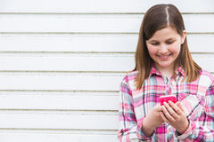 Pre Teen Girl Texting On Mobile Phone In Urban Setting. Pre Teen Girl Texting On Mobile Phone Stock Images