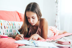 Pre teen girl writing diary Royalty Free Stock Images