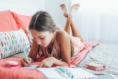 Pre teen girl writing diary Stock Photo