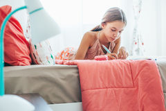 Pre teen girl writing diary Royalty Free Stock Photography