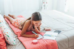 Pre teen girl writing diary Stock Image