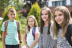 Pre-teen School Pupils Outside of the Classroom Royalty Free Stock Photography