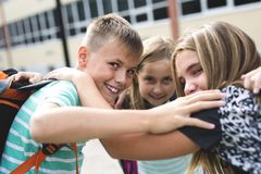 Pre-teen School Pupils Outside of the Classroom Royalty Free Stock Image