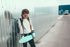 Pre teen skater on the city street Stock Photo