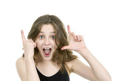 Pre teen girl looking at camera making hand gesture Stock Photo