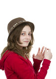 Pre teen girl posing with a hat Stock Photography