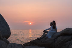 Pre wedding outdoor romantic sunse. T beach dress romance girlfriend boyfriend Royalty Free Stock Images