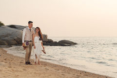 Pre wedding outdoor romantic. Sunset beach dress romance girlfriend boyfriend Royalty Free Stock Photo