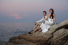 Pre wedding outdoor romantic. Sunset beach dress romance girlfriend boyfriend Royalty Free Stock Image