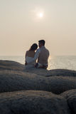Pre wedding outdoor romantic sunset. Beach dress romance girlfriend boyfriend Stock Photos