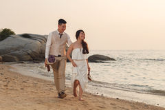 Pre wedding outdoor romantic. Sunset beach dress romance girlfriend boyfriend Stock Photography