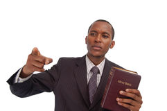 The Preacher. This is an image of man holding a bible. This image can be used to represent sermon, preaching etc royalty free stock image