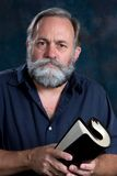 Preacher Holding Rolled Bible. Preacher holds rolled bible in both hands stock image
