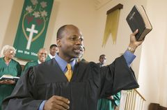 Preacher Preaching the Gospel in church stock photography