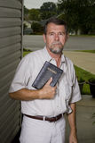 Preacher at your door. Local church preacher inviting neighbors to hear the gospel stock images